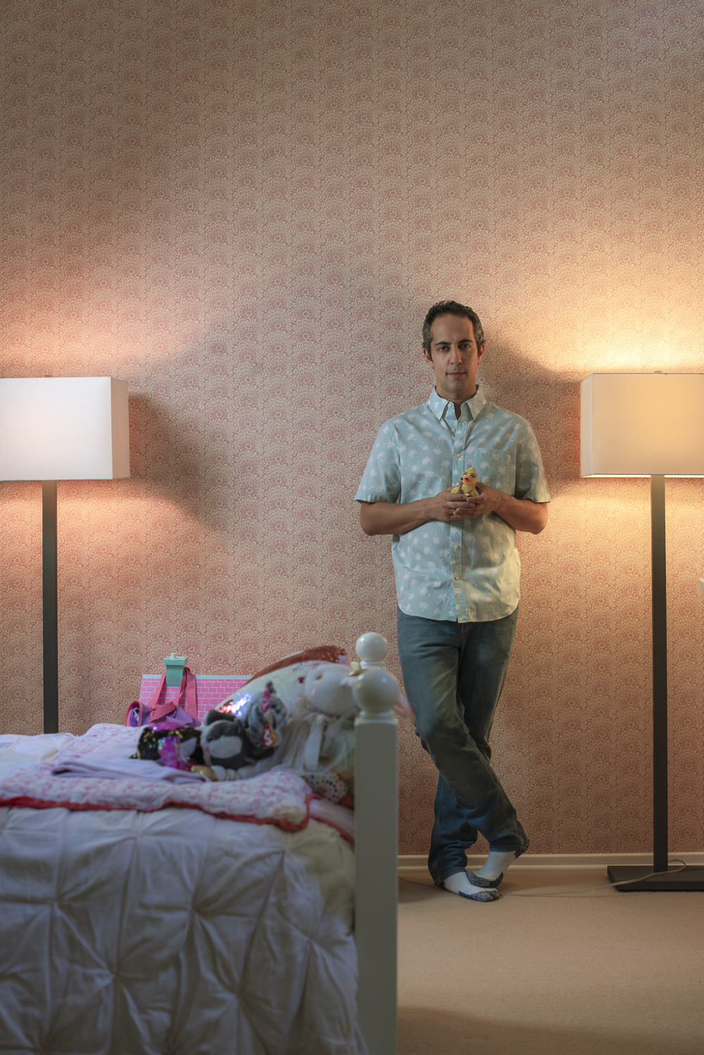 Abdi Nazemian in bedroom with doll